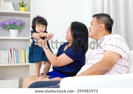 Asian family having fun at home - stock photo