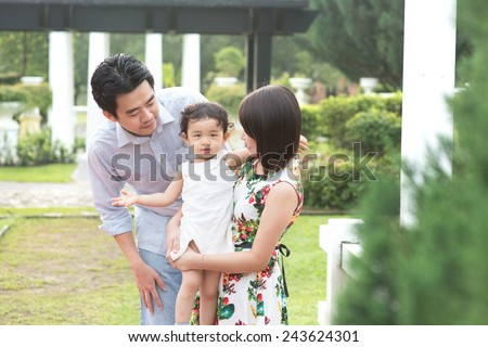 asian family having fun at the outdoor park
