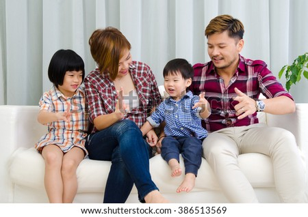 Asian family having fun in the living room