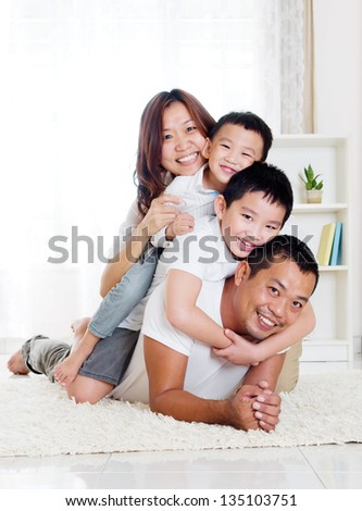 Asian family having piggyback fun - stock photo