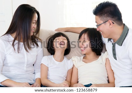 Asian family having pleasant conversation at home.