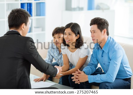 Asian family meeting real estate agent - stock photo