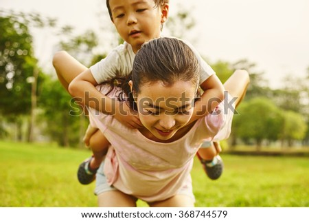 Asian family mom and boy in the park - stock photo