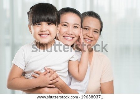 Asian family of three female bonding together - stock photo