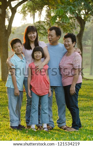 asian family outdoor enjoyment and quality time, full body - stock photo