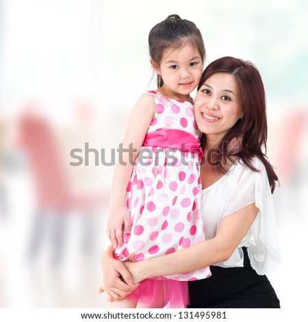 Asian family parent and child. Mother and daughter at home. - stock photo