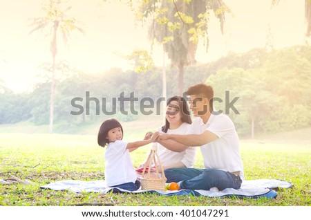Asian family picnic - stock photo