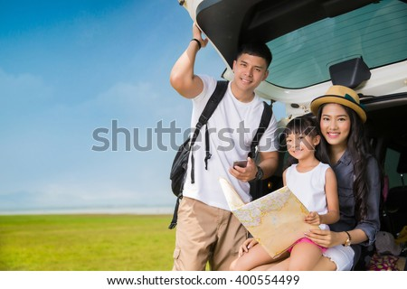 Asian family planning a trip mother and daughter looking at map - stock photo