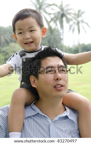 asian family playing on outdoor