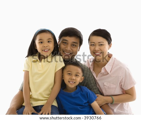 Asian family portrait against white background.