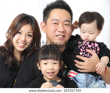 Asian Family portrait inside home with white background