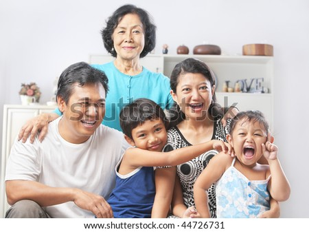 Asian family portrait with their grandmother. PS: stitching image for the tightly crop area of grandma's head make additional height to the image - stock photo