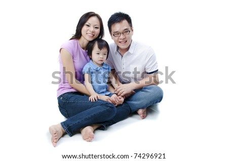 asian family sitting with white isolated background - stock photo