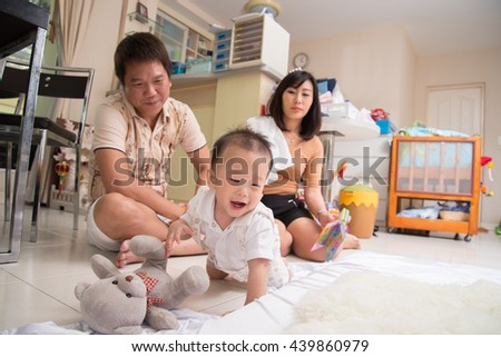 Asian family together in the house indoor with happy face - stock photo