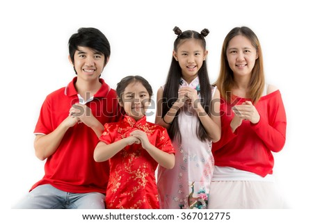 Asian family wishing you a happy Chinese new year on isolated background