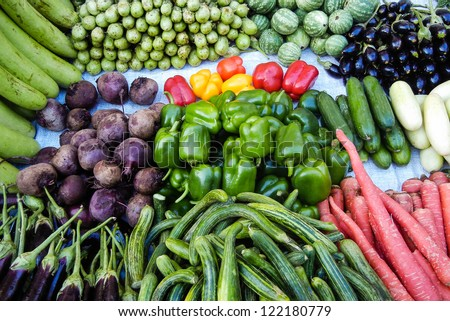 Asian farmer's market selling fresh vegetables - stock photo