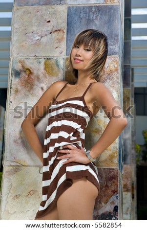 Asian Fashion Model in Stripped Dress