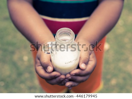 Asian fat boy drinking a glass of milk , Vintage tone - stock photo