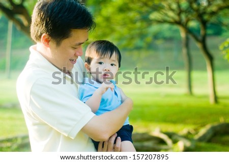 Asian father and son - stock photo