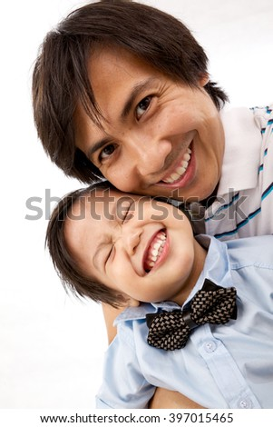 Asian Father And Son Self Portrait - stock photo