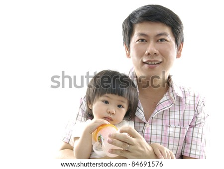 Asian father holding her little daughter on white background - stock photo