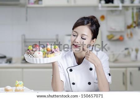 Asian female chef in chef whites uniform - stock photo