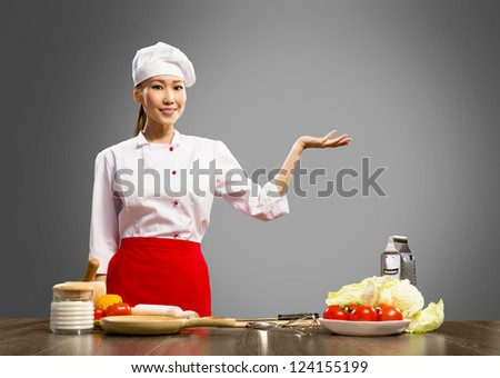 Asian female chef shows up on the place for text - stock photo