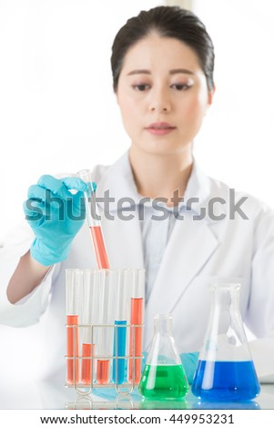 Asian female forensic scientist finally a breakthrough in laboratory - stock photo