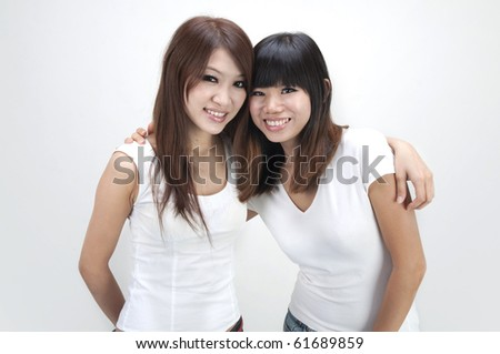 asian female friends hugging - stock photo