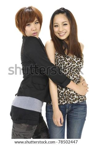Asian female having fun together. - stock photo