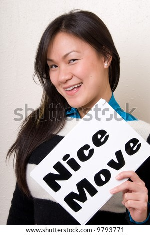 Asian female holding a nice move sign.