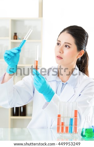 Asian female scientist Braving new medical frontiers in laboratory - stock photo