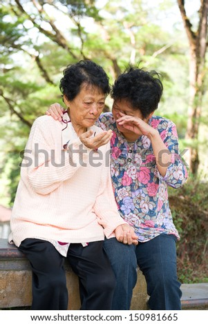 asian female senior crying and having depression - stock photo