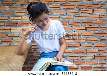 Asian female student reading.