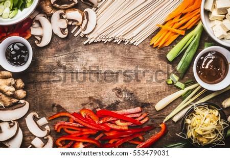 Asian food background vegetarian cooking ingredients stock photo asian food background with vegetarian cooking ingredients and chopsticks tofu noodles ginger forumfinder Images