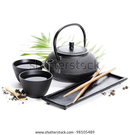 Asian food concept (Tea pot and chopsticks) - stock photo