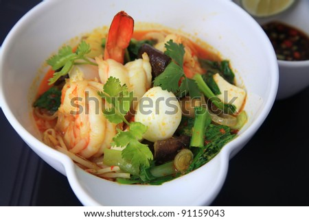 asian food named laksa with prawn and quail egg - stock photo