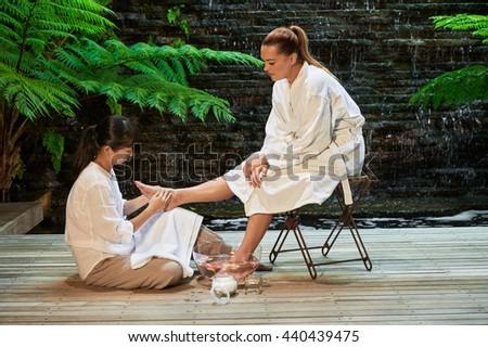 asian foot massage salts gentle spa treatment - stock photo