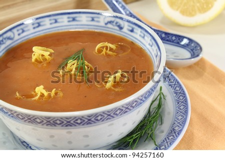 Asian fresh lobster soup with lemon, dill and bread - stock photo