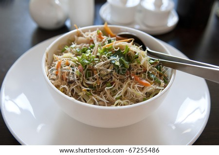 asian fried rice noodle on a bowl - stock photo