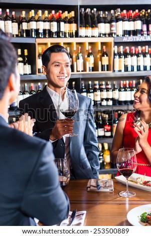 Asian friends celebrating in restaurant - stock photo