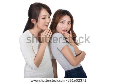 Asian friends' whisper, full length portrait. - stock photo