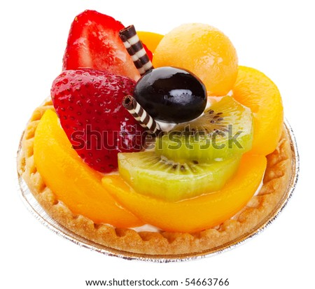 Asian fruit tart stacked high with kiwi, peach, strawberries, melon, and grape. Delicate rolls of striped white and dark chocolate garnish the center like mock chopsticks.  Shot on white background. - stock photo