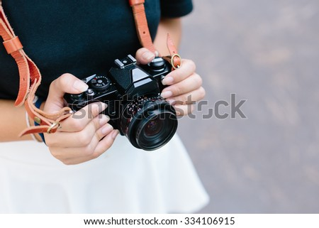 Asian girl and black vintage film camera