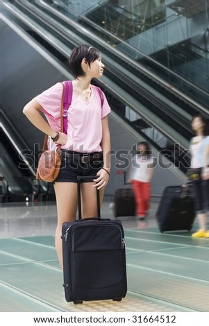 asian girl at singapore's changi airport