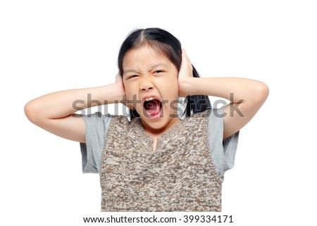 asian girl covering her ears with hands.