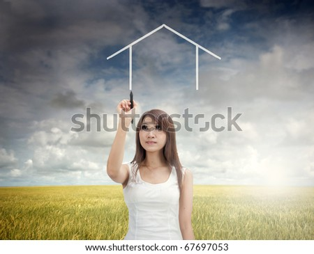 asian girl drawing a dream home during early morning - stock photo