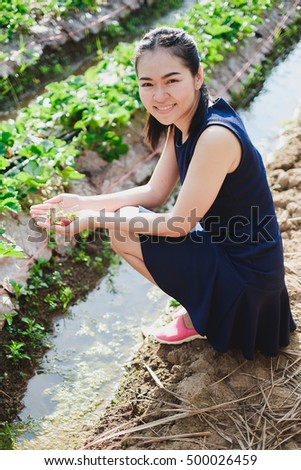 Asian girl enjoy free time at strawberry farm