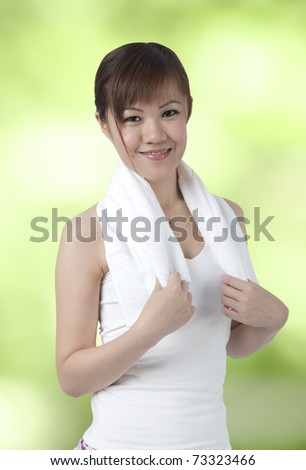asian girl exercise with green outdoor - stock photo