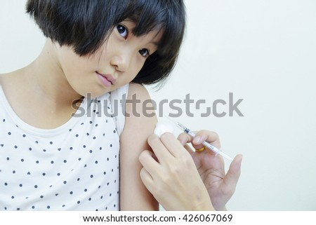 asian girl get vaccination - stock photo
